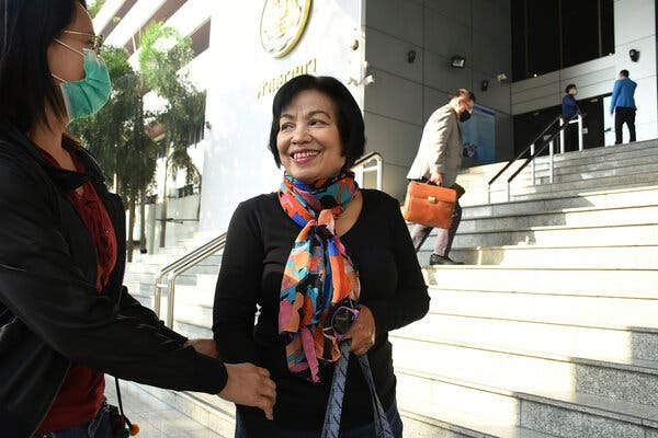 The former Thai civil servant identified as Anchan P. arrived at court in Bangkok on Tuesday before her sentencing on lèse-majesté charges.