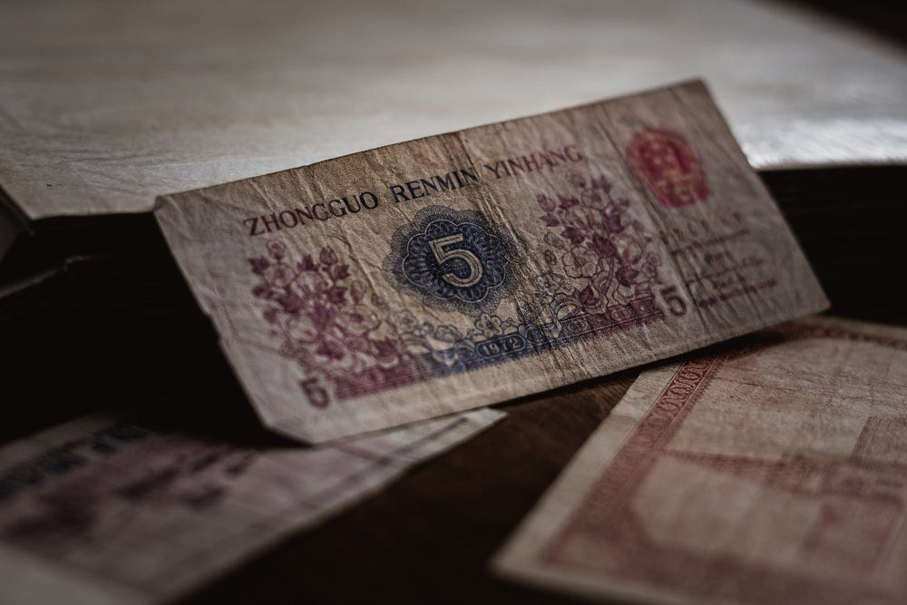 5 banknote on brown surface
