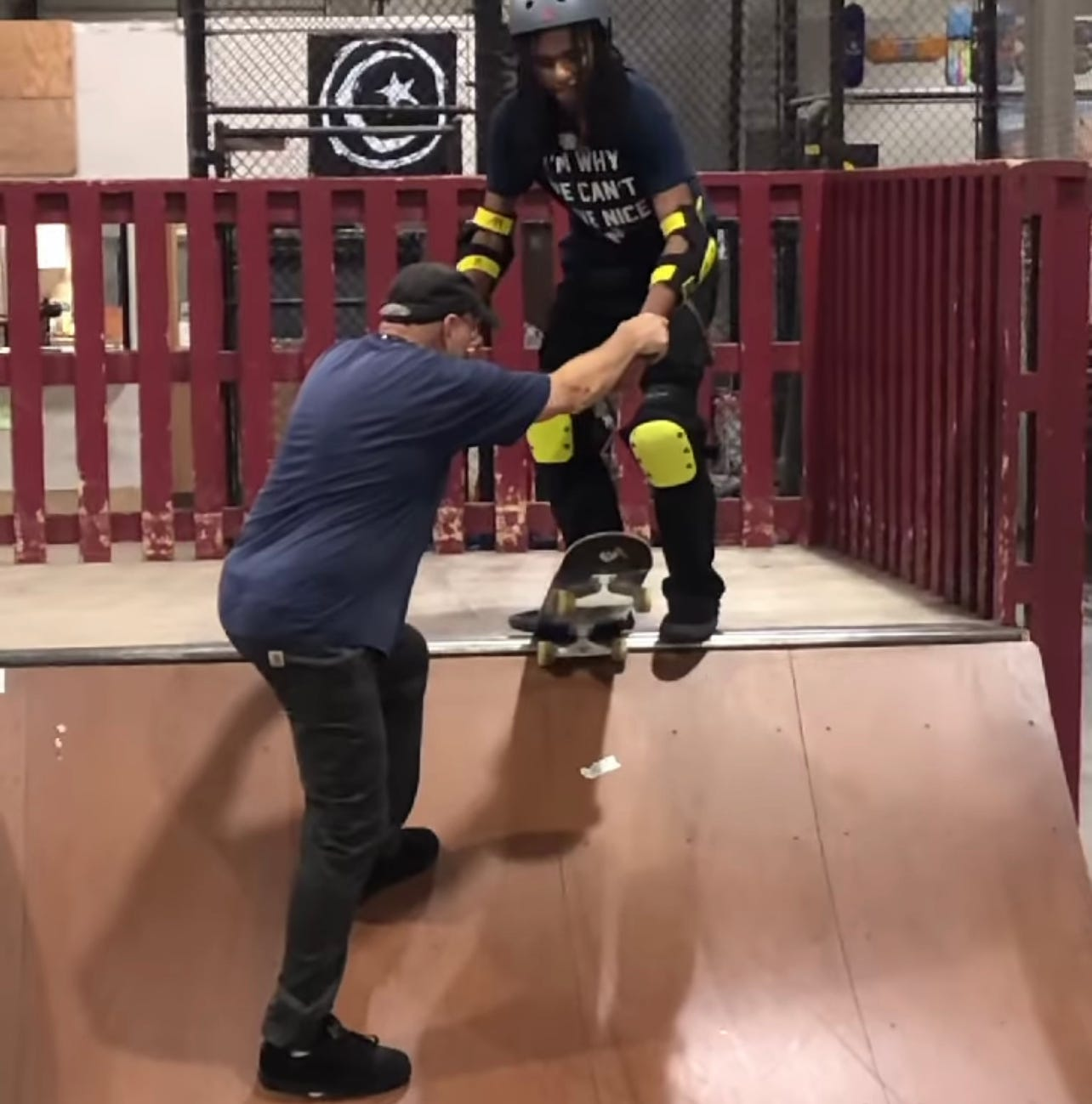 Owner of Modern Skate, George Leichtweis teaching Blind Skater, Coco Atama how to drop in for the first time in his life