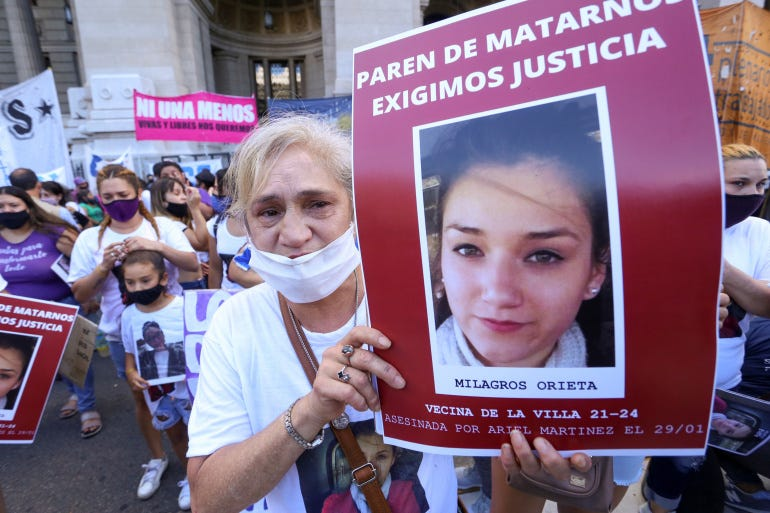 A demonstrator holds a sign reading, 'Stop killing us, we demand justice', during a protest against violence towards women, in Buenos Aires, Argentina [Flor Guzzetti/Reuters]