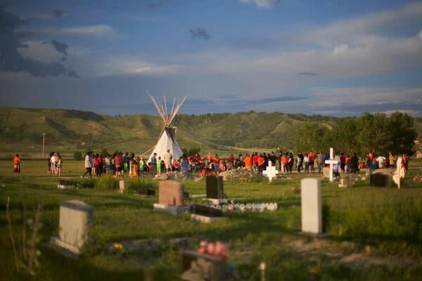 A vigil on Saturday at the site of the former Marieval Indian Residential School, where more than 750 unmarked graves were found, on the Cowessess First Nation in Saskatchewan.
