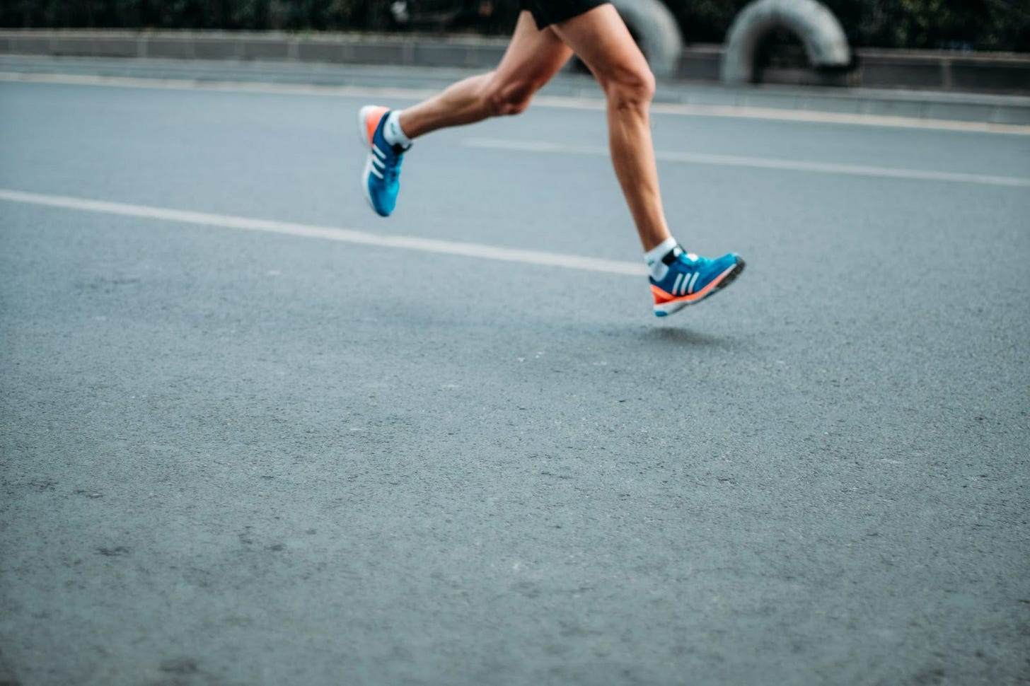 A man in running shoes speeds across the tack.