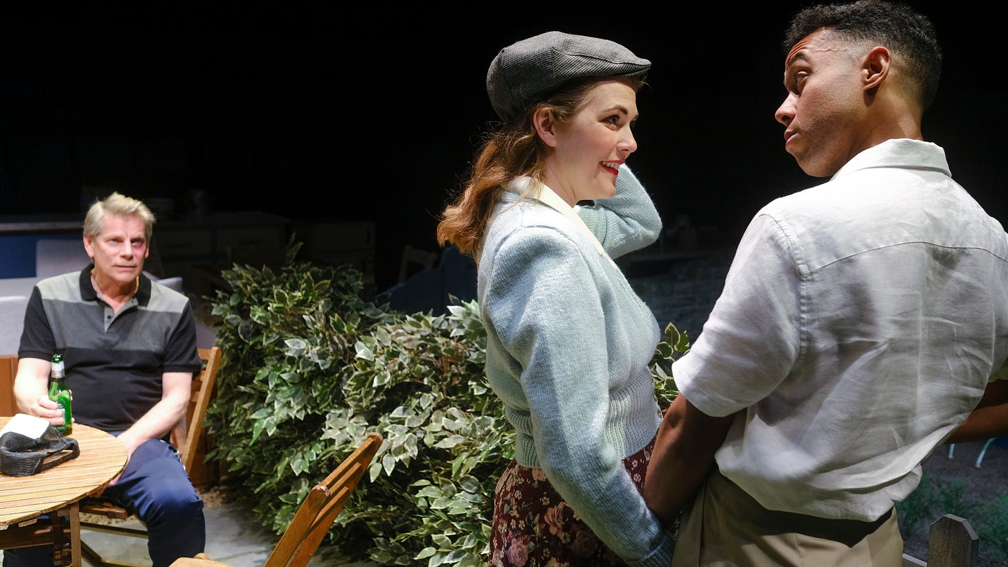 A 21st-century Covid man looks on whistfully as a Second World War housewife embraces her black soldier husband.