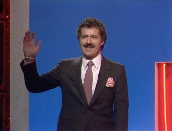 """Mr. Trebek in his first appearance on """"Jeopardy!"""" in 1984. In the years since, he hosted every episode except one, on April Fool's Day in 1997."""