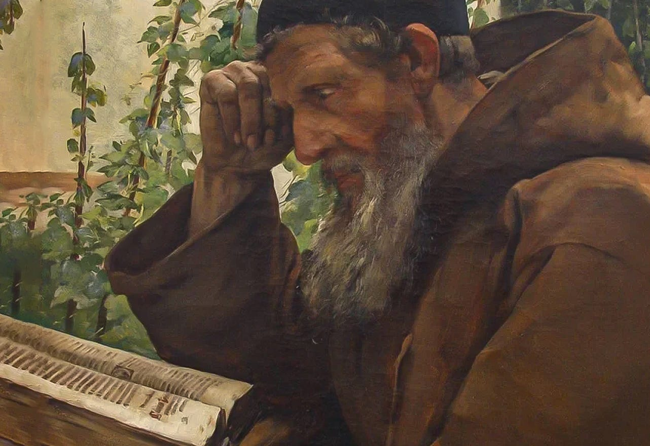 old priest reading bible