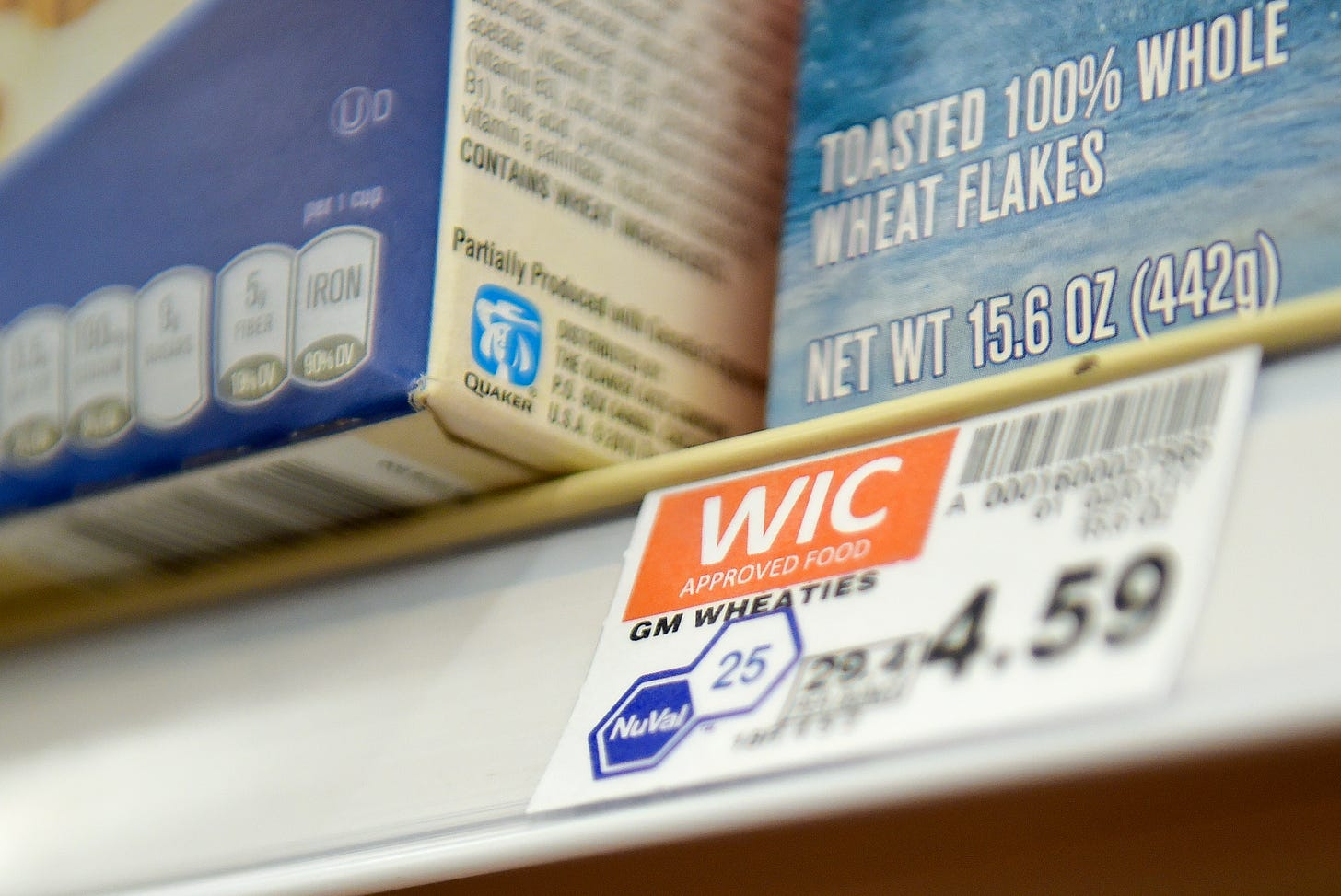 Items approved for the WIC program are labeled next to their price on the shelf.