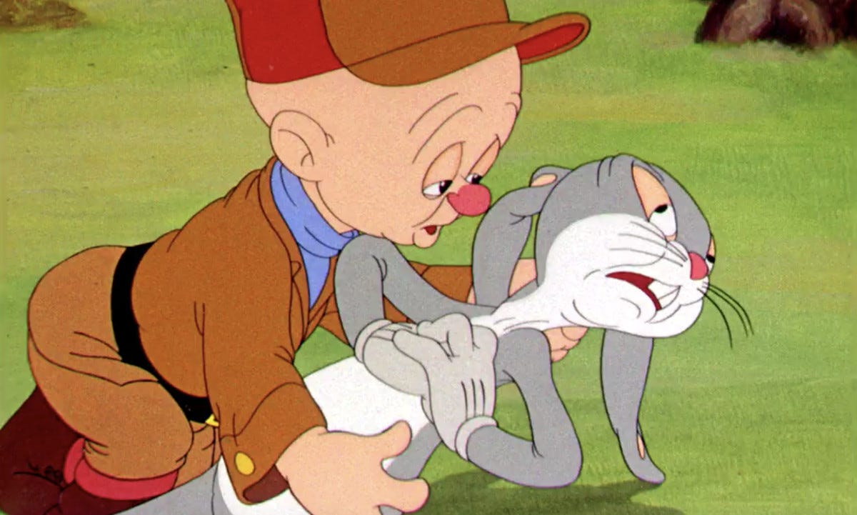 Elmer Fudd sadly holds Bugs, who's pretending at great length that he's dying