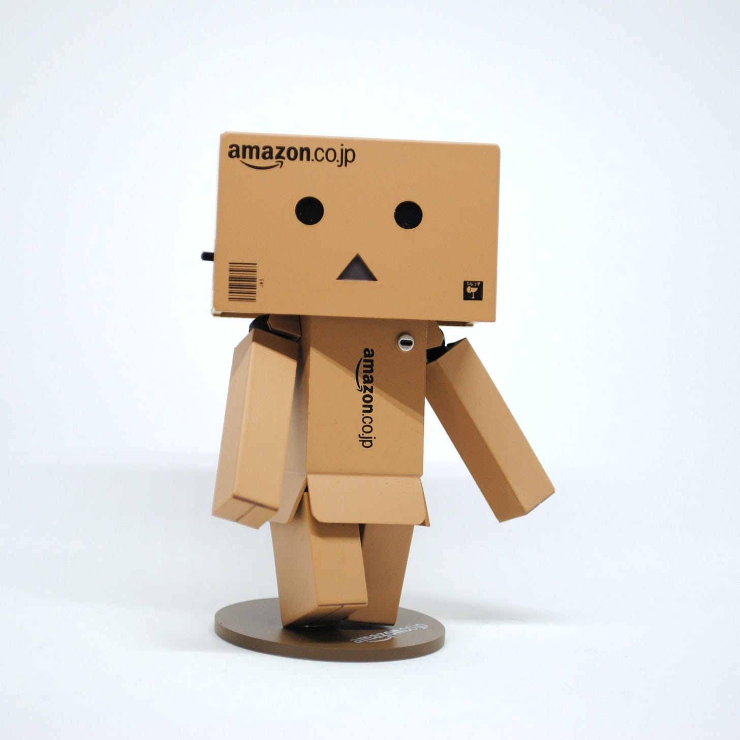 Photo of a man made out of Amazon-branded cardboard boxes. Unsplash