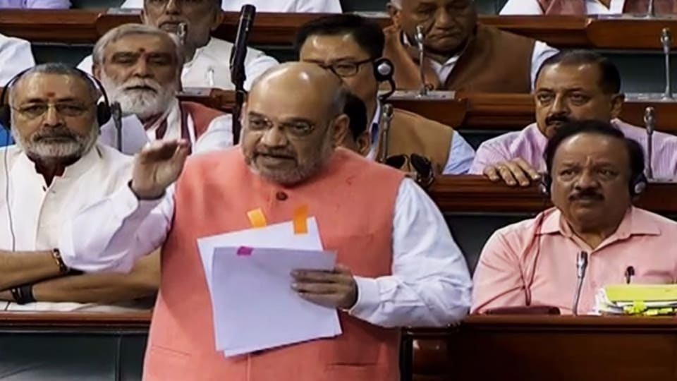 Union Home Minister Amit Shah responds to the debate in the Lok Sabha to revoke Article 370 in LokSabha on Tuesday. (ANI Photo)