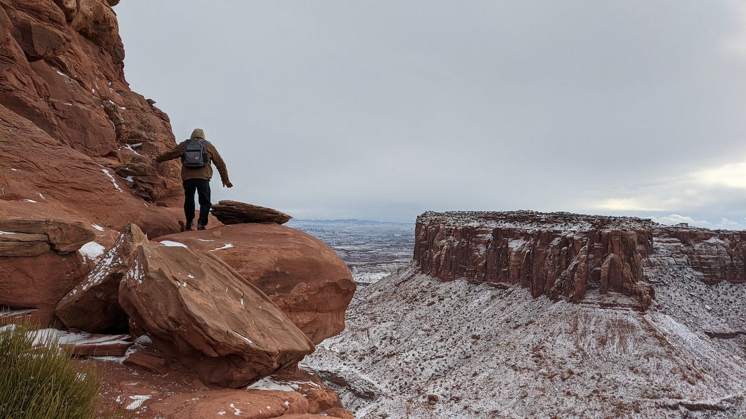 a picture of me on the edge of a wide canyon in the snow