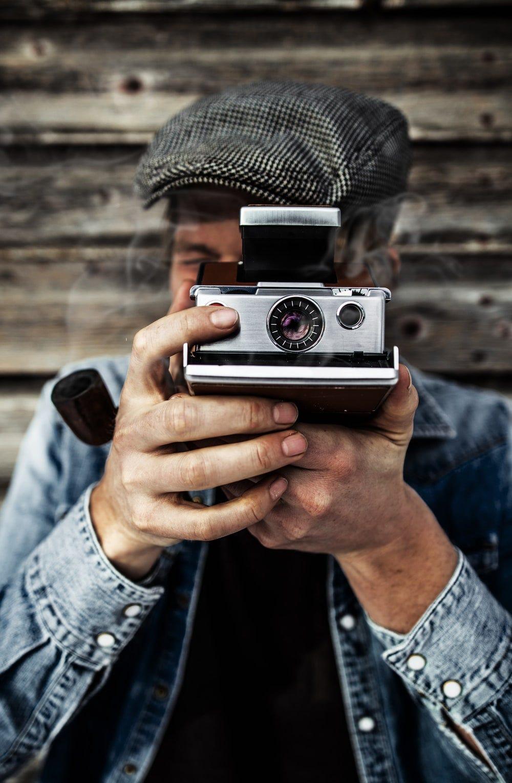 person using gray camera