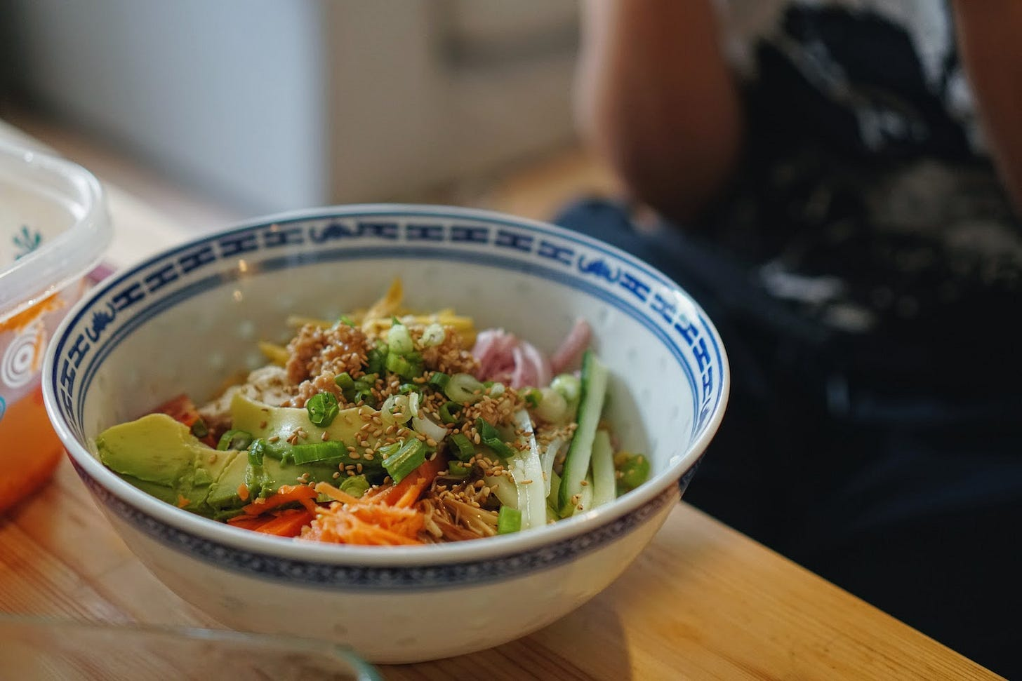 Hiyashi chuka in a bowl in front of Yoko