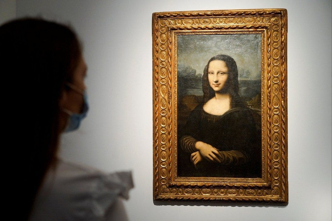 A woman looks at the Hekking Mona Lisa, a reproduction of Leonardo Da Vinci's Mona Lisa, at Christie's auction house in Paris. Photo: Reuters