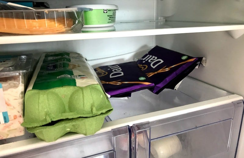 Image of 2 bars of dairy milk inside my fridge