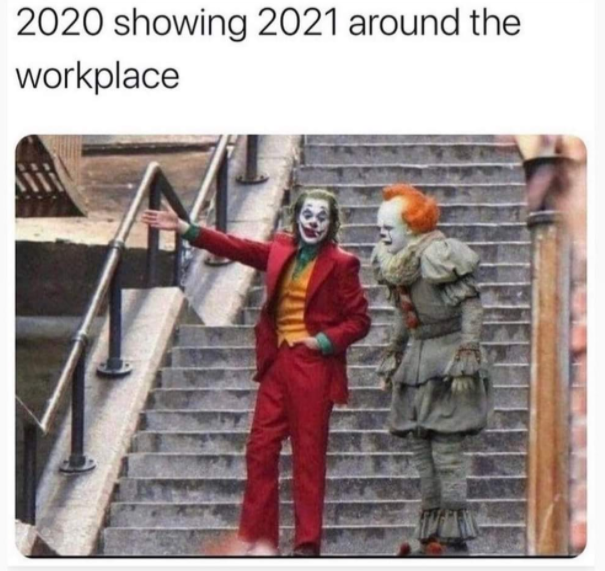 "Image of The Joker with an outstretched arm standing on a staircase with Pennywise, the evil clown from Stephen King's IT. The caption on the photo reads, ""2020 showing 2021 around the workplace"""