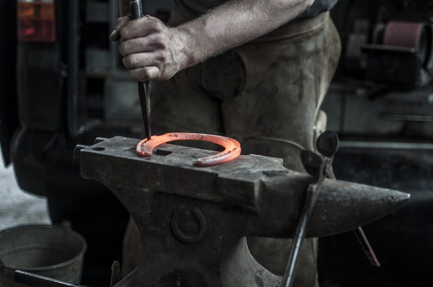 """image of a blacksmith working for article titled """"go where work is hard"""""""