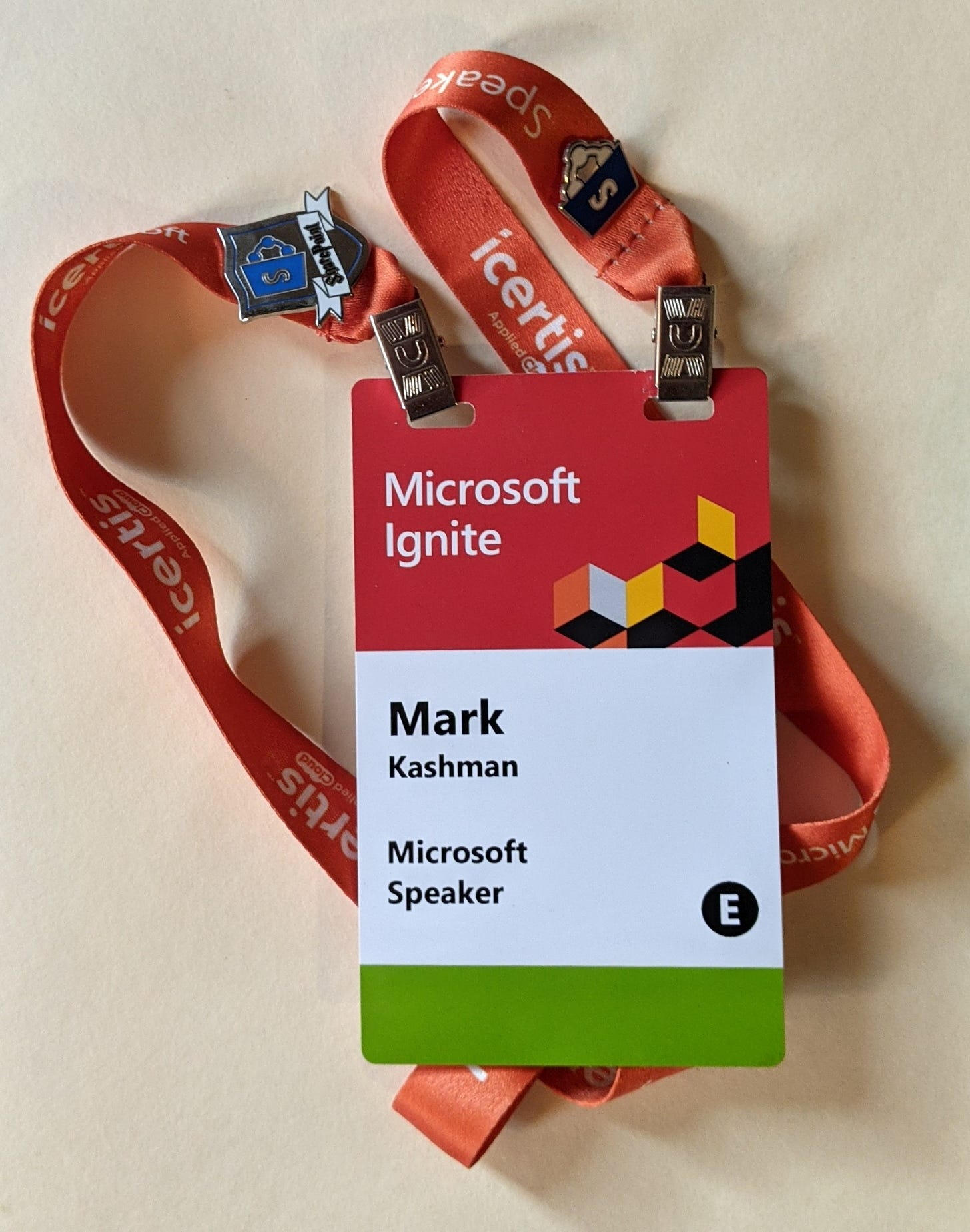 Microsoft Ignite 2019 event badge with SharePoint pins.