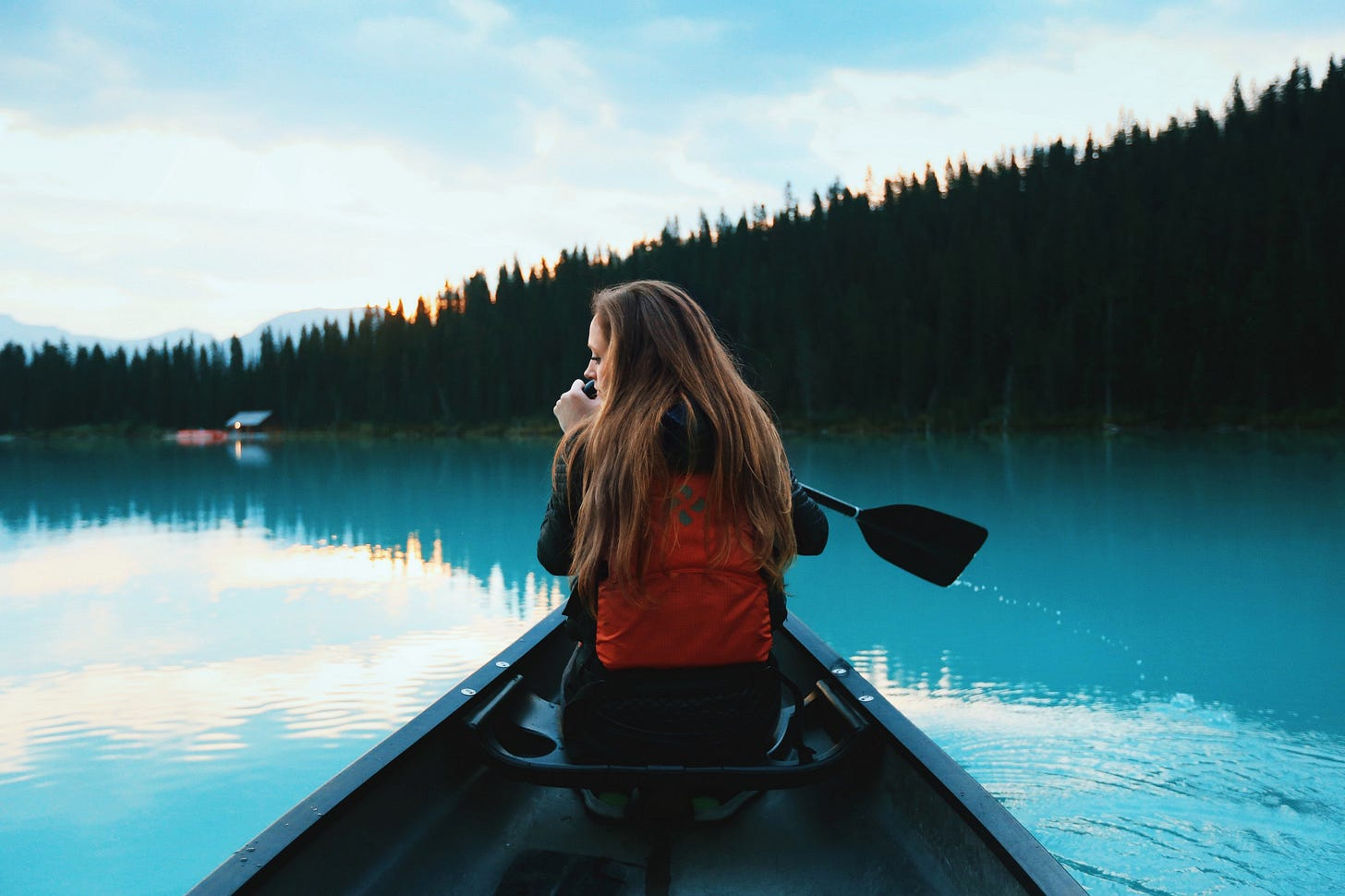 image of a girl in a canoe on a still lake for article by Larry G. Maguire