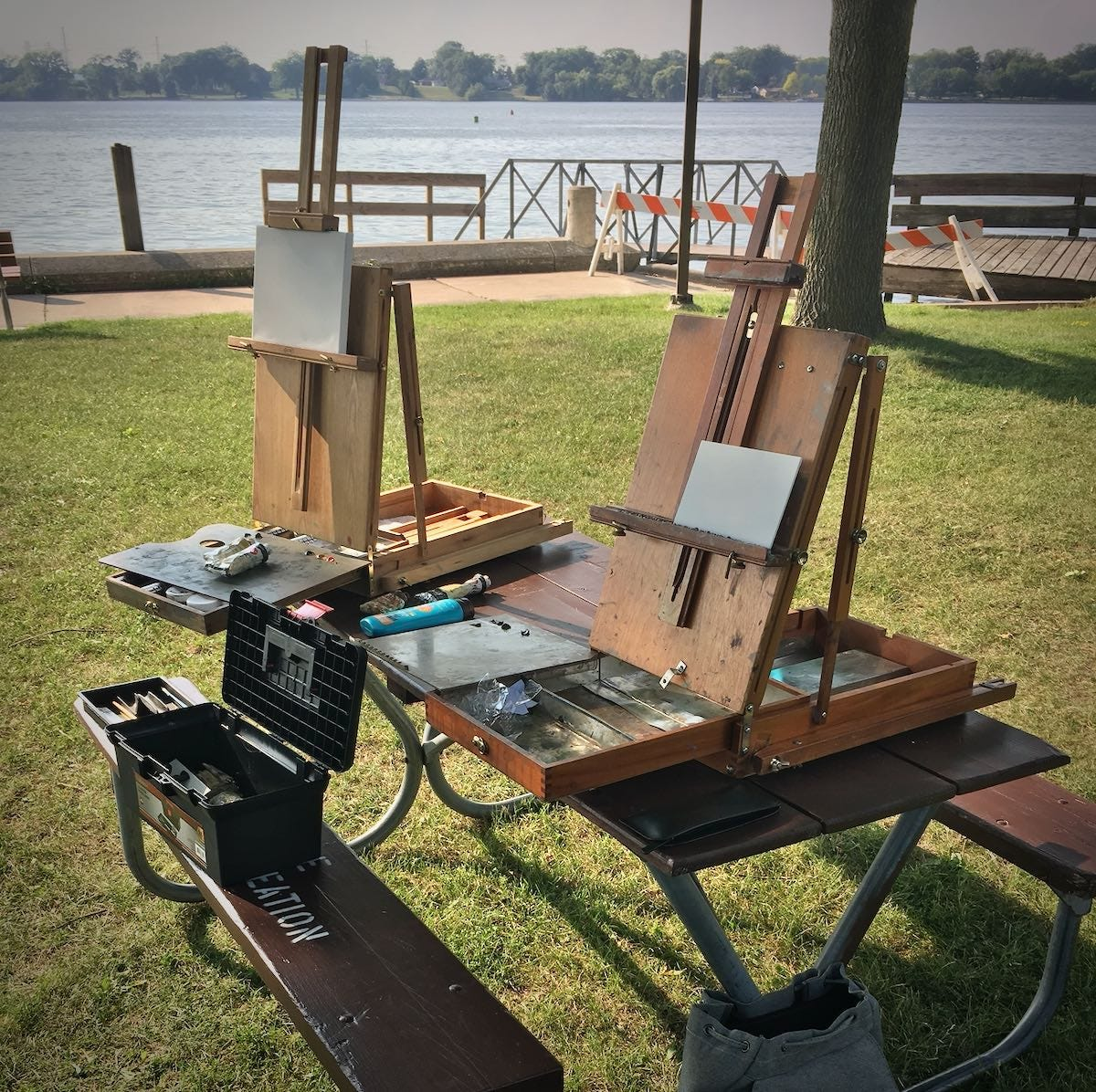 Easels on a picnic table at the park.