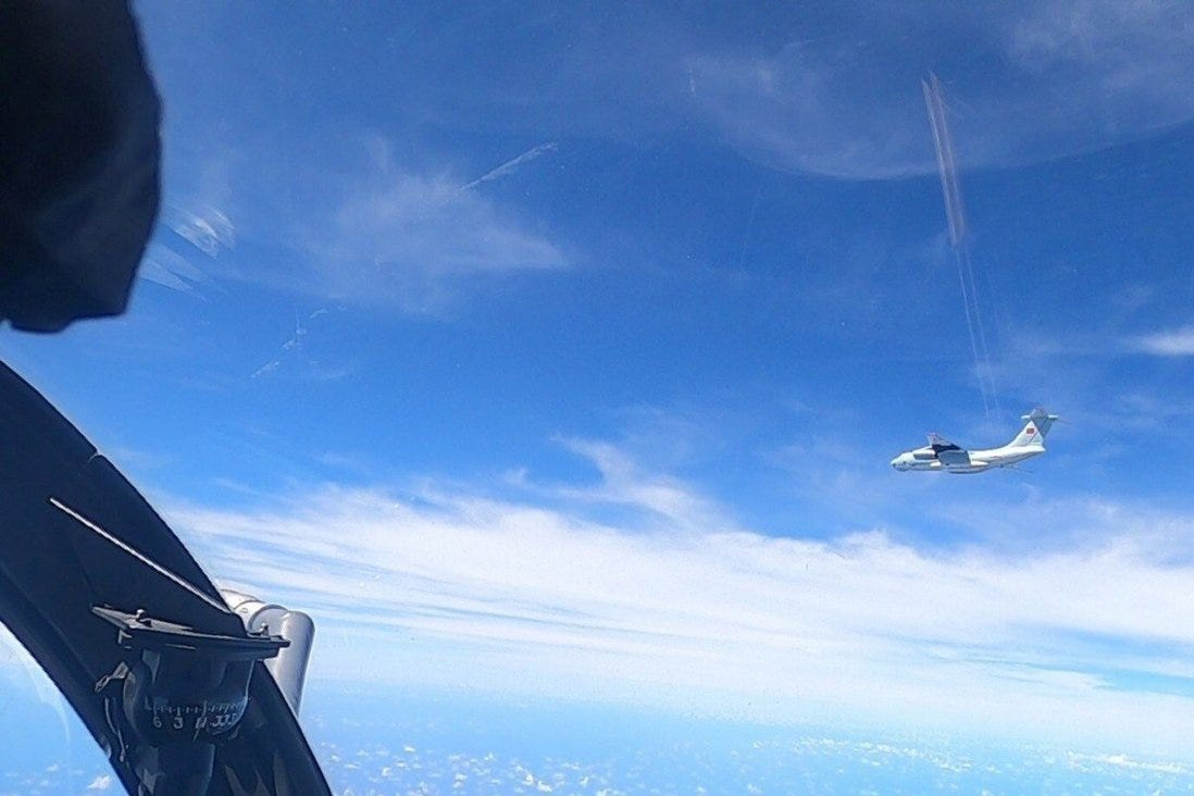 A plane with a Chinese flag on its tail in a picture supplied by the Royal Malaysian Air Force on Monday. Photo: Reuters