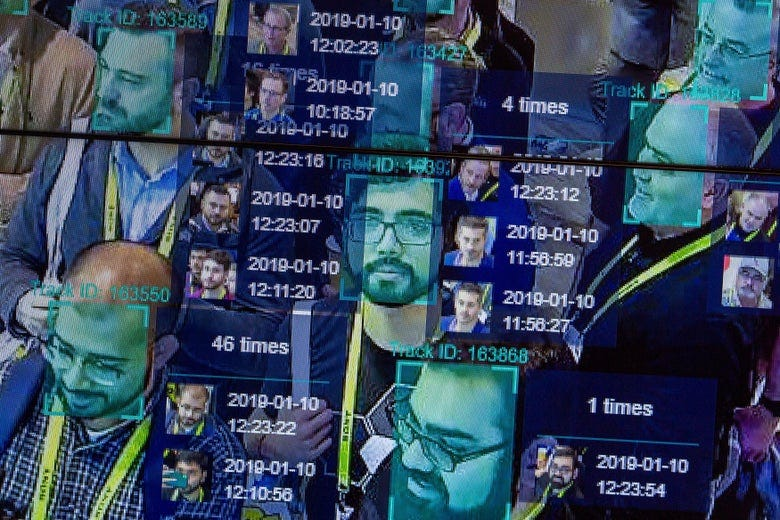 Faces in a crowd are overlaid with computer data from facial recognition technology.