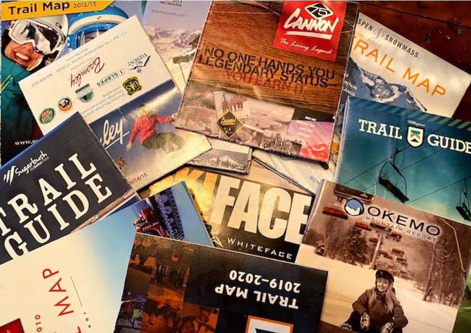 Pile of ski maps