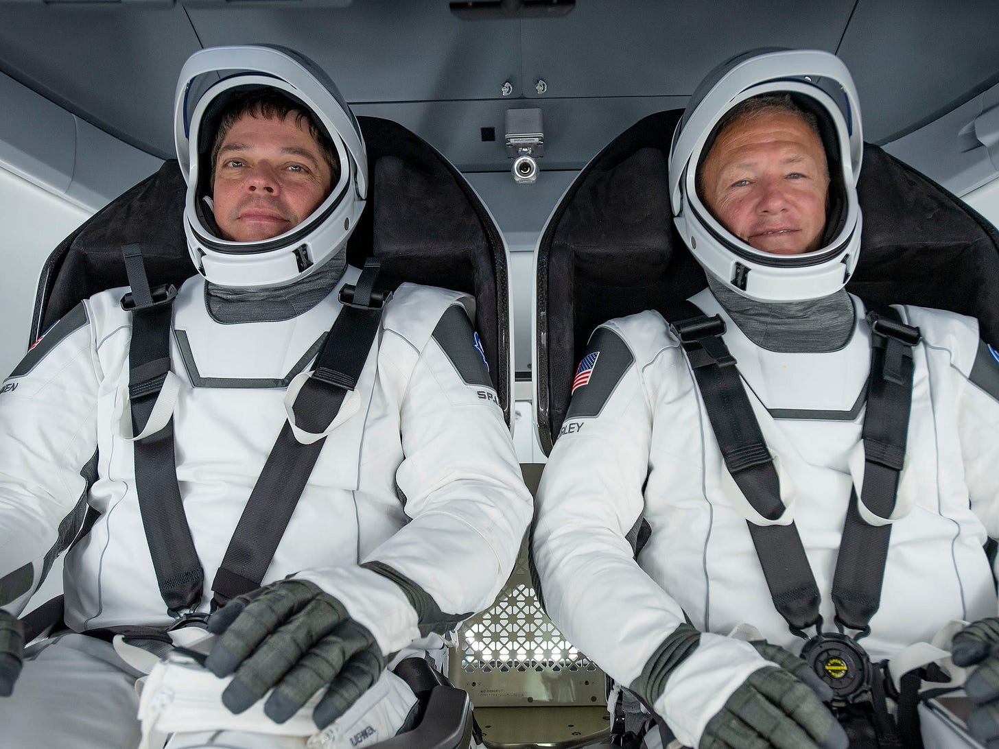 nasa astronauts bob behnken doug hurley spacex spacesuits crew dragon spaceship seats training demo2 demo 2