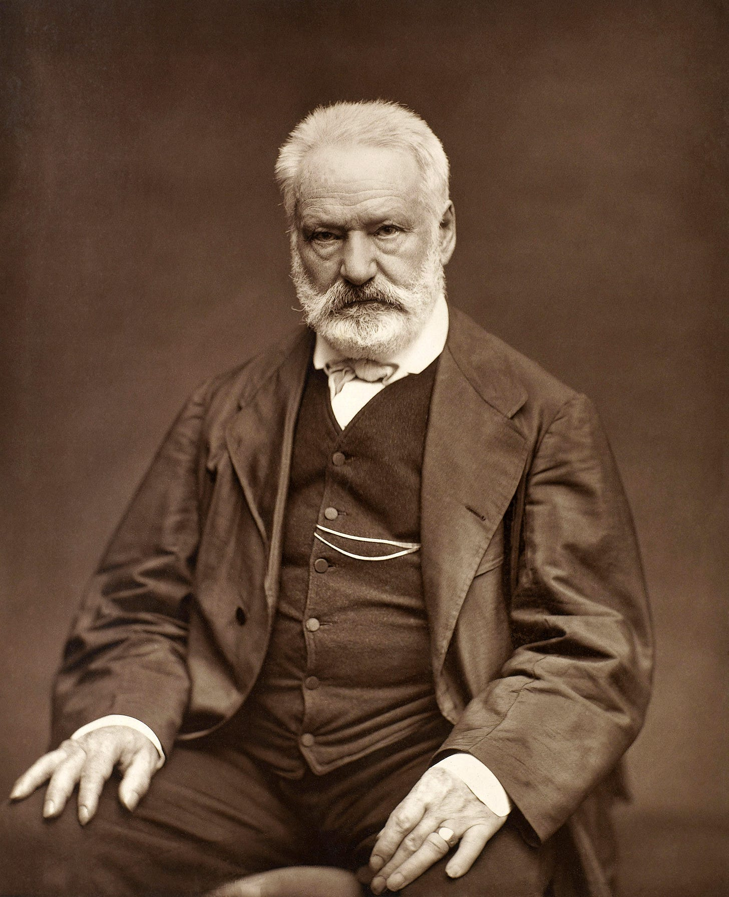 https://upload.wikimedia.org/wikipedia/commons/e/e6/Victor_Hugo_by_%C3%89tienne_Carjat_1876_-_full.jpg