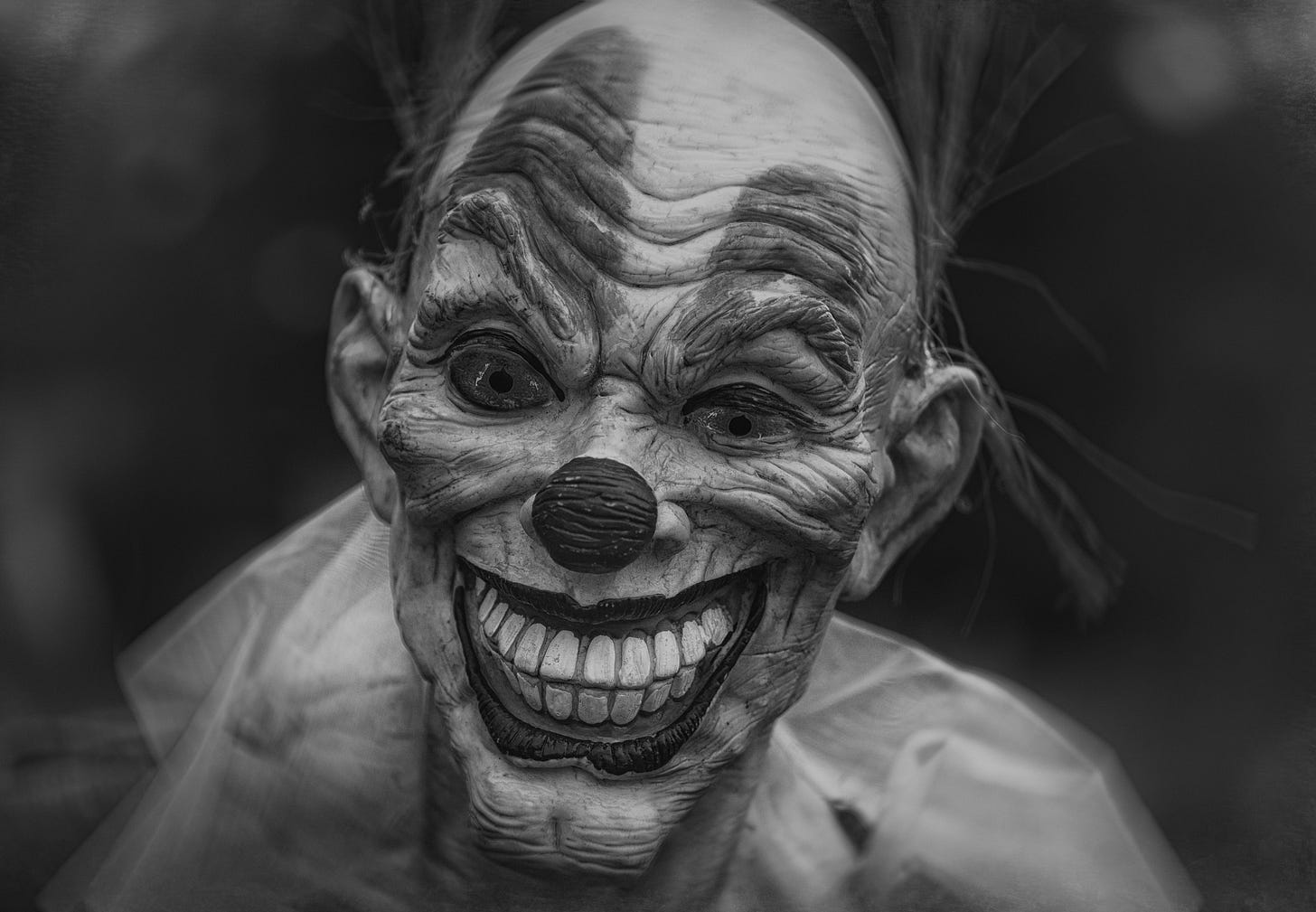 black and white image of a weird clown for article by Larry G. Maguire