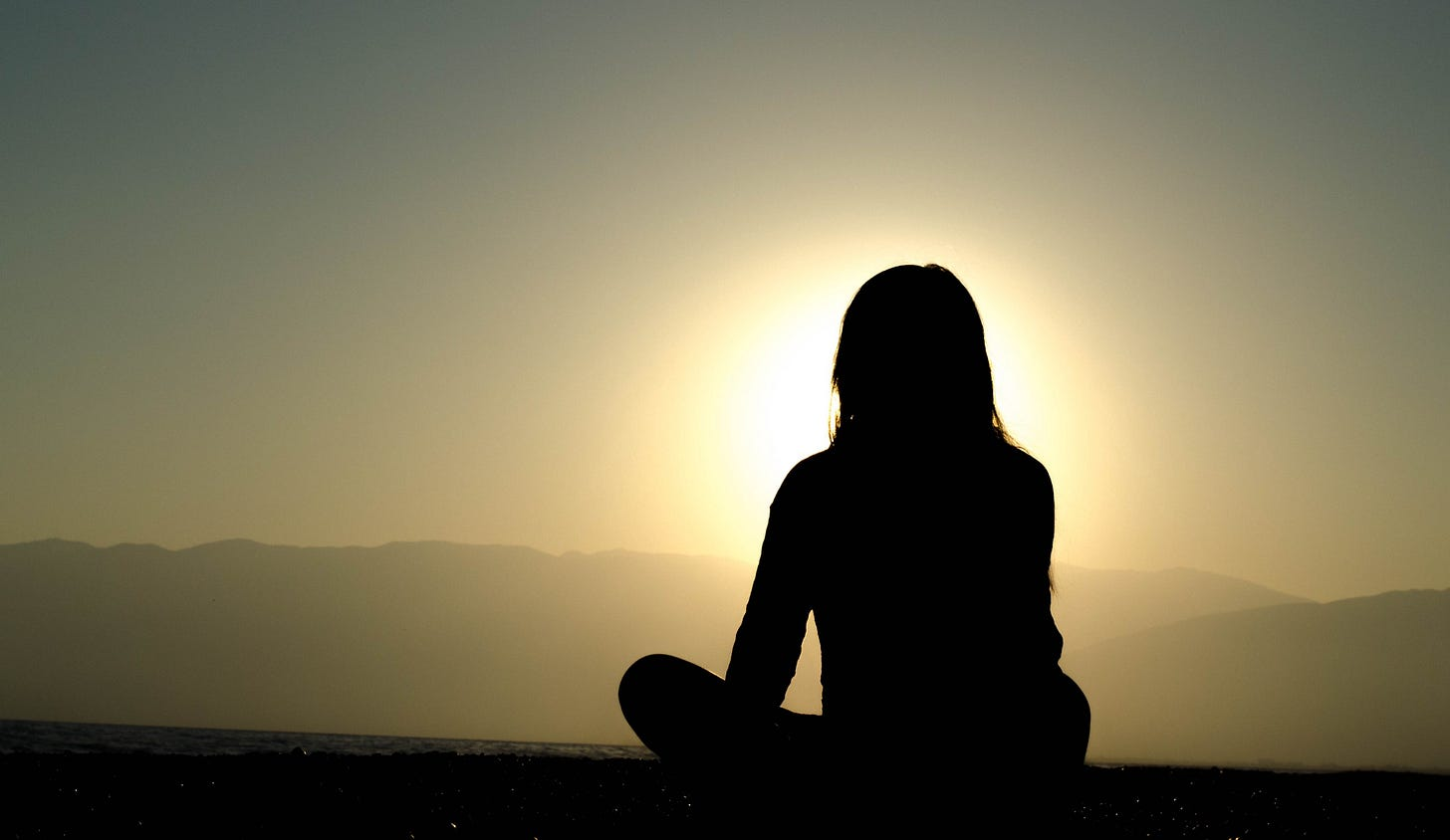"""Image of a silhouette of a girl against the setting sun for article titled """"why creativity flourishes in solitude"""" on medium"""