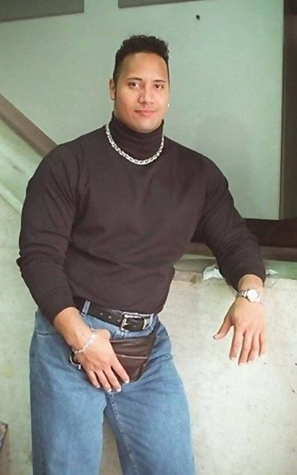 dwayne the rock johnson wearing a fanny pack filled with poptarts and condoms