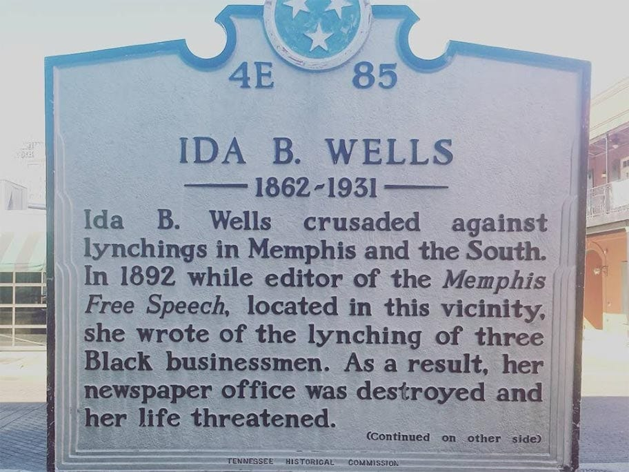 """A plaque describing the life of Ida B. Wells. It reads: """"Ida B. Wells crusaded against the lynchings in Memphis and the South. In 1892 while editor of the Memphis Free Speech, located in this vicinity, she wrote of the lynching of three Black businessmen. As a result, her newspaper office was destroyed and her life threatened."""""""