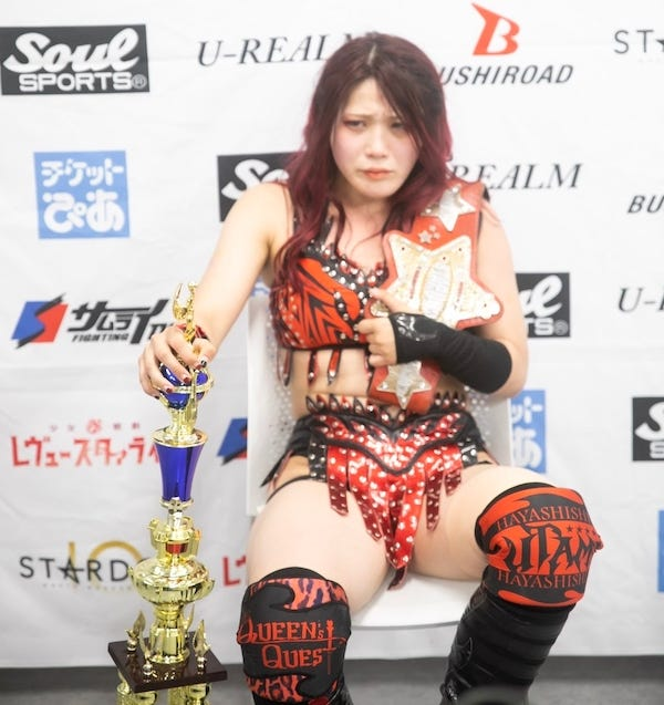 Utami Hayashishita answers questions at a press conference after a successful defense of the World of Stardom title