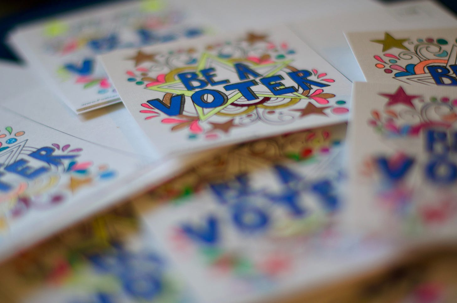 """Pile of """"Be a Voter"""" stickers"""