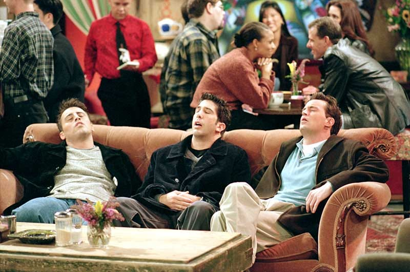 """Matt LeBlanc as Joey, David Schwimmer as Ross, and Matthew Perry as Chandler, sitting on couch with eyes closed, in Central Perk coffee house from episode """"The One Where They're Going To Party""""."""