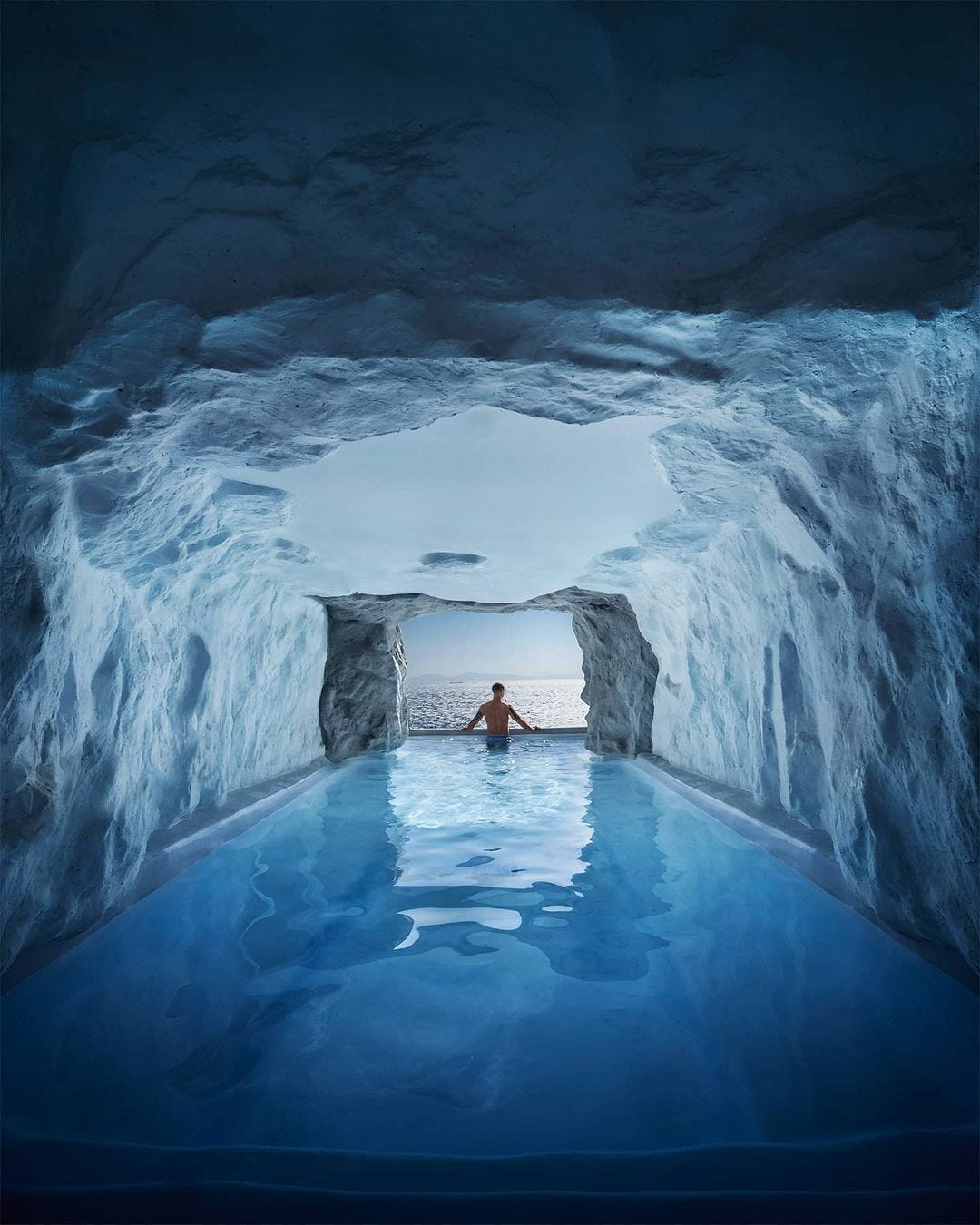 Man in ice cave pool