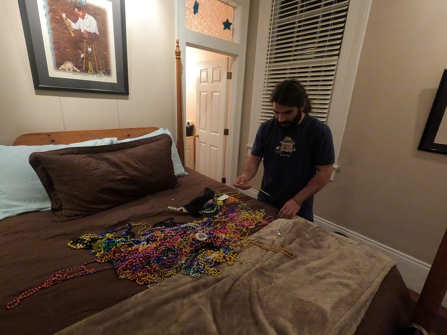 anthony looks down at the bed covered in hundred of colorful beads