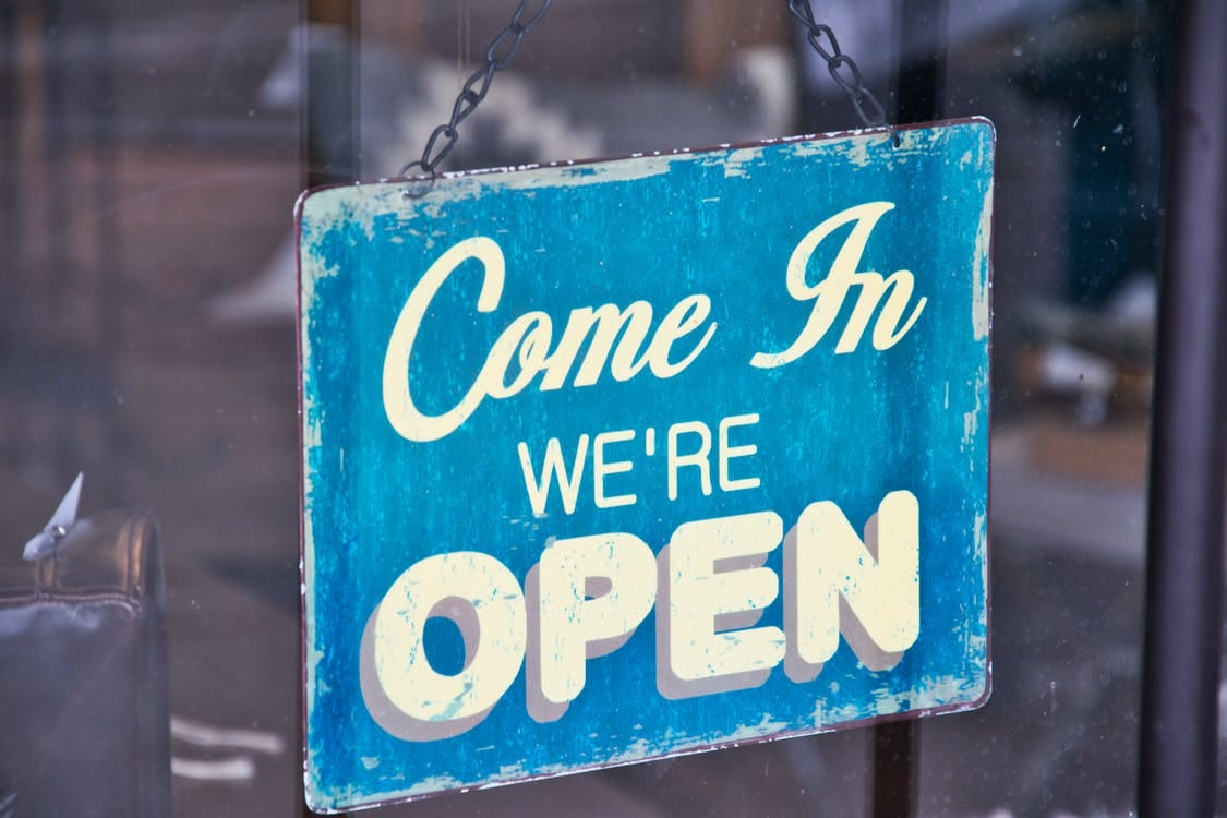 Blue and White Come in We're Open Signboard