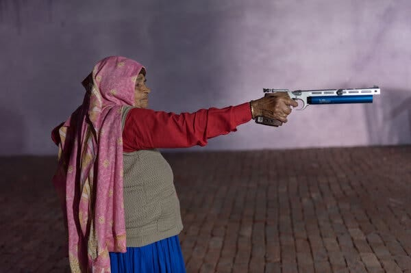 Chandro Tomar practicing with an air pistol last month at the site of a shooting range she is building in her home in the Indian state of Uttar Pradesh.