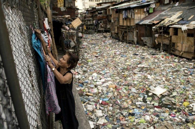 Manila 'trash bin' waterway choked with plastic