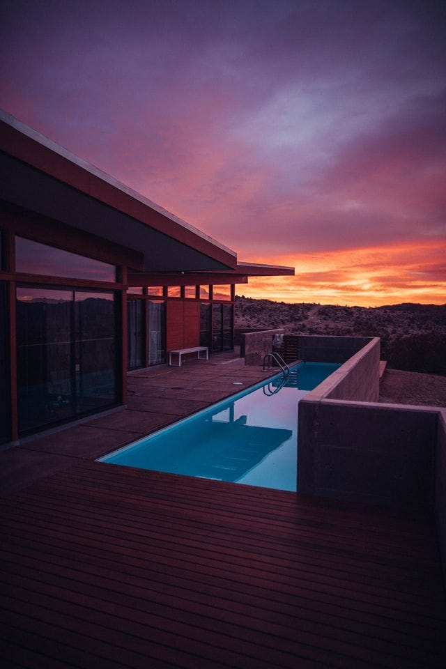 home with pool overlooking the desert and sunset