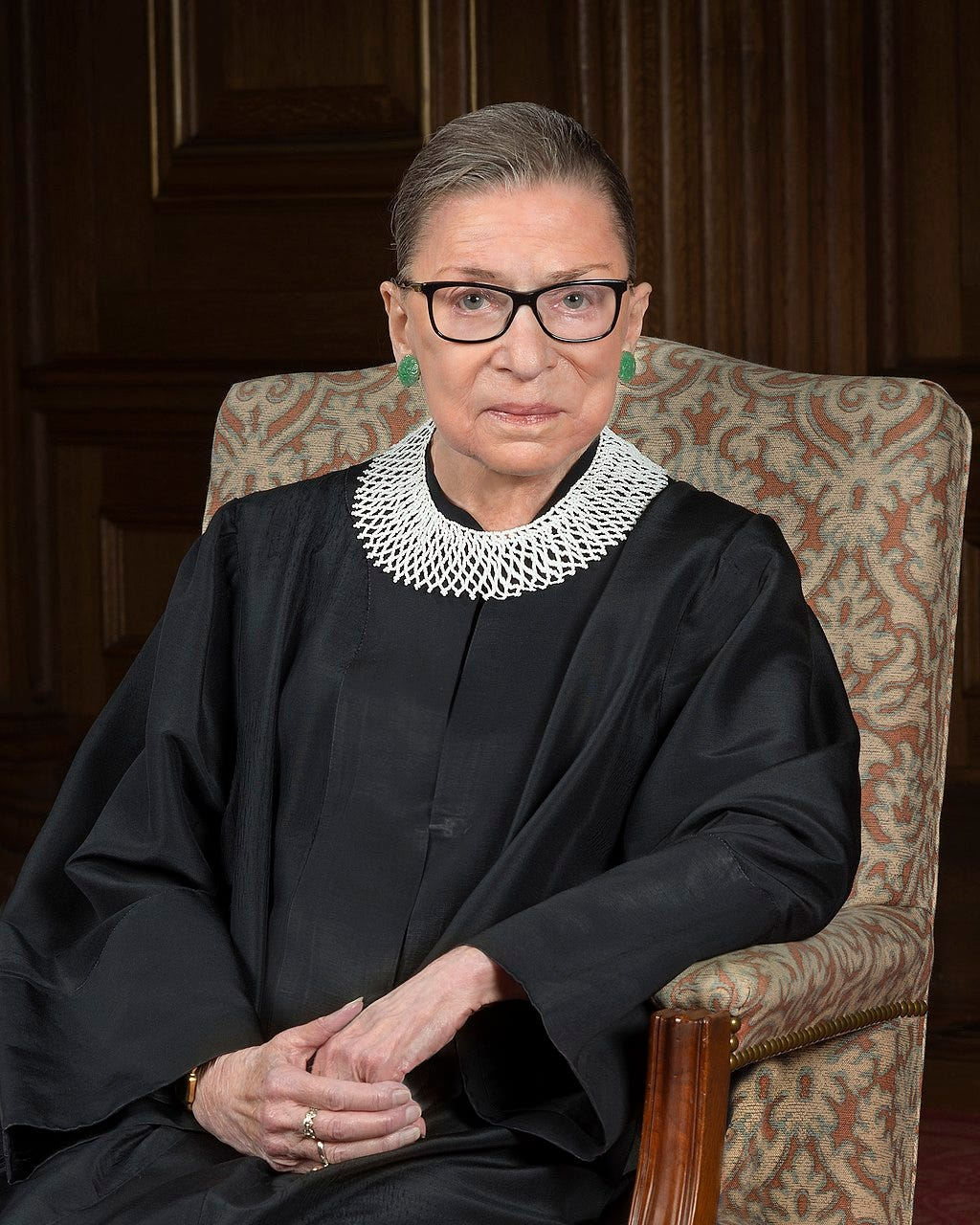 Ginsburg seated in her robe