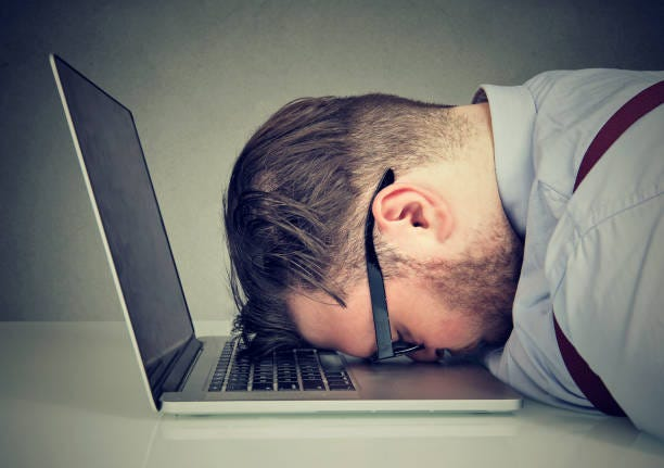 Overworked man lying on laptop Side view of chubby man looking broken while lying on top of laptop. Failure stock pictures, royalty-free photos & images