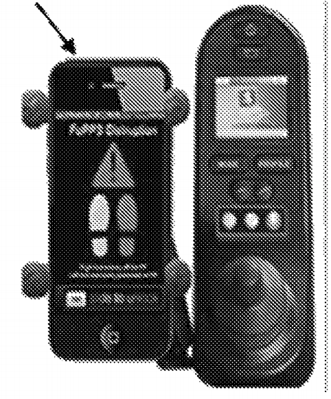 Image of a smartphone holder next to the remote controls of a power wheelchair.