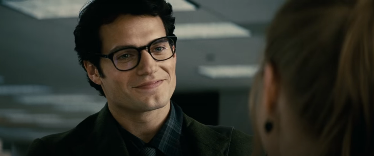 """A shot from the ending sequence of 'Man of Steel'. Clark Kent smiles at Lois Lane, who has just welcomed him to """"the planet."""""""