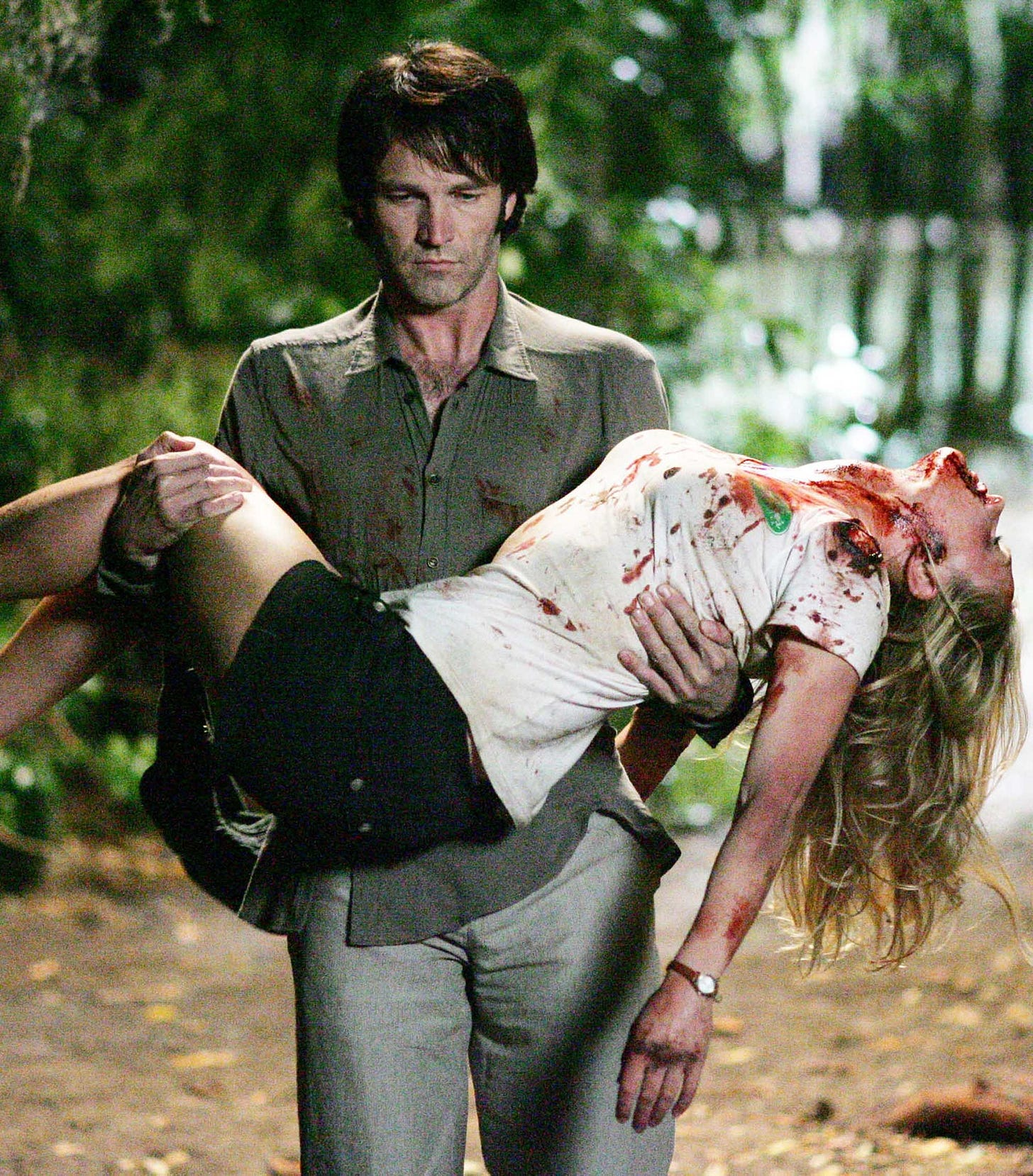 Bill Compton (Stephen Moyer) carries a bloody Sookie Stackhouse (Anna Paquin) in the pilot episode of HBO's True Blood