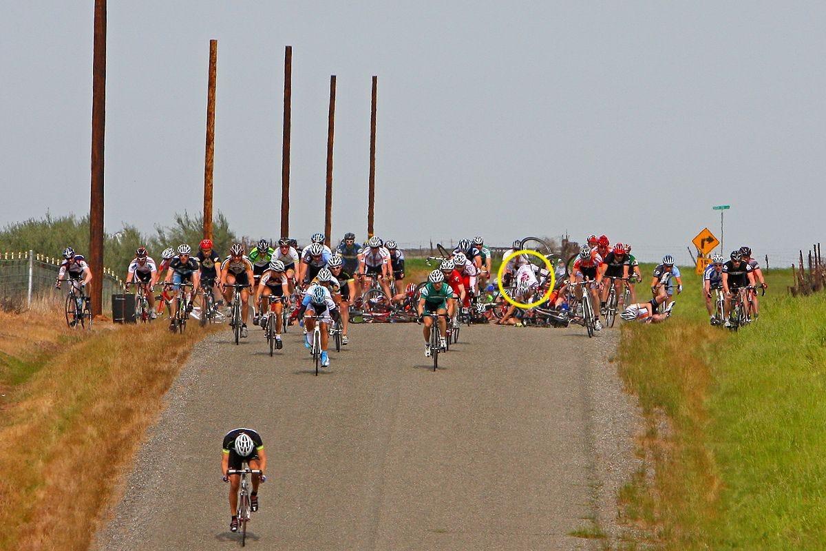 Photo of a bike race crash. Ken Norton is circled.