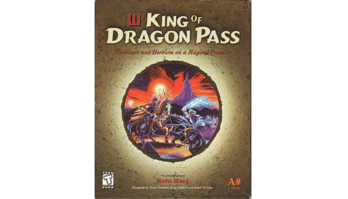 """Software box with title """"King of Dragon Pass"""" and a circular artwork showing two magic-wielding warriors on horseback in front of a jagged purple mountain and a red-hued sky."""