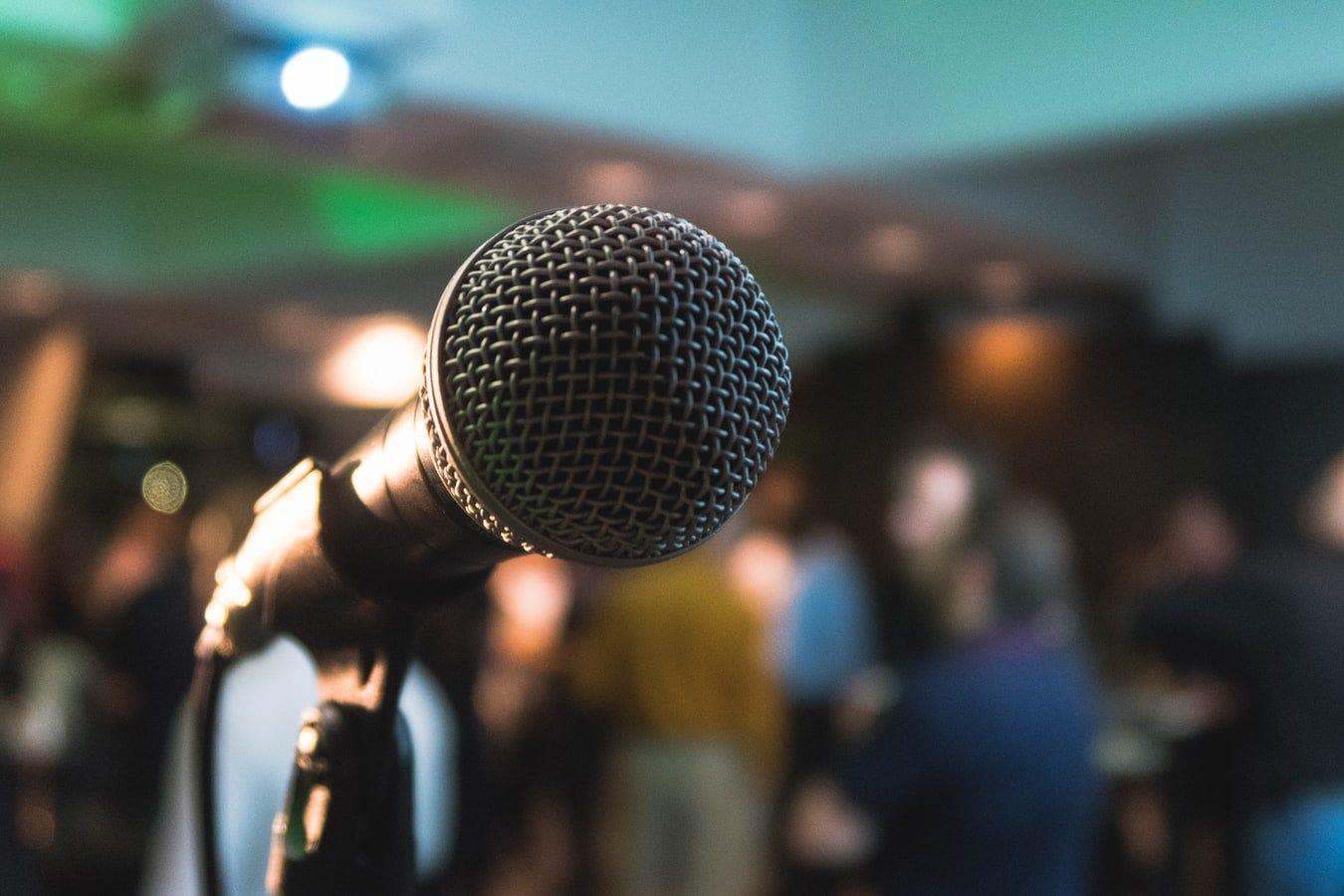 Microphone pointed toward speaker.