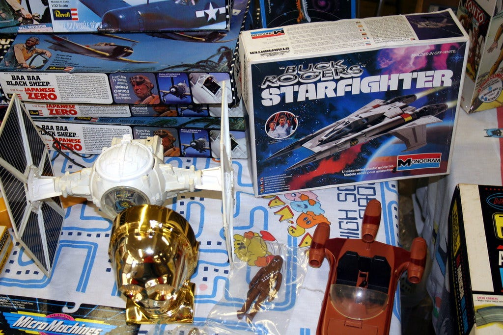 """""""TIE Fighter, Buck Rogers Starfighter, C3PO head, and Landspeeder"""" by skpy is licensed under CC BY-SA 2.0"""